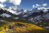 Sunlight on Golden Aspen Trees and Snow-covered Mountains Photographic Print by Robbie George