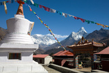 Prayer Flags Fly Above the Tenboche Monastery Photographic Print by Dmitri Alexander