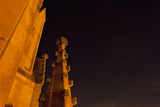 The Spires of Shapard Tower Against a Starry Night Sky Photographic Print by Stephen Alvarez