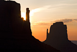 Silhouetted the Mittens Rock Formation at Sunrise Photographic Print by Derek Von Briesen