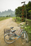 Bicycles Are Parked on a Road by a Restaurant Near Yangshuo, China Photographic Print by Jonathan Kingston