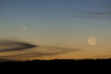 Comet C/2011 L4 (PANSTARRS) and a Setting New Moon on March 12, 2013 Photographic Print by Stephen Alvarez
