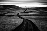 A Road Passing Through a Landscape of Gentle Hills Photographic Print by Jonathan Irish