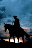 Cowboy Silhouette in Sunset Poster Posters
