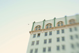 Pigeon Flying Near the Rooftop of An Art Deco Building Photographic Print by Jena Ardell