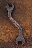 Heavy Double-headed Spanner with Bend in Handle Lying On Rusty Metal Sheet Photographic Print by Den Reader