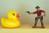 Duck Takes On Cowboy Photographic Print by Den Reader