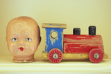 Doll Head And Toy Train Photographic Print by Den Reader