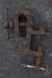 Rusty Metal Vice Or Clamp Lying On Rusty Metal Sheet Photographic Print by Den Reader