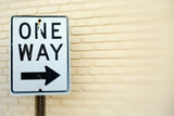 One Way Sign Against Yellow Brick Wall Shot with Tilt Shift Lens Photographic Print by Jena Ardell