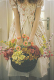 A Basket Full of Flowers Photographic Print by Michalina Wozniak