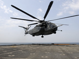 An MH-53E Sea Dragon Prepares To Land On the Flight Deck Aboard USS Ponce Photographic Print by Stocktrek Images