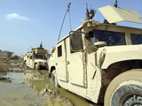 Soldiers Work To Remove Their Humvees Out of the Mud Photographic Print by Stocktrek Images