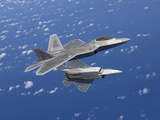 Two F-22 Raptors Maneuver While Flying a Training Mission Over Japan Photographic Print by Stocktrek Images