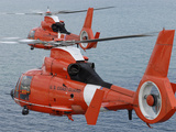Two Coast Guard HH-65C Dolphin Helicopters Fly in Formation Over the Atlantic Ocean Photographic Print by Stocktrek Images