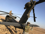 Soldiers Prepare a UH-60 Black Hawk Helicopter For Transport Photographic Print by Stocktrek Images