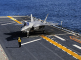 An F-35B Lightning II Makes a Vertical Landing On the Flight Deck of USS Wasp Photographic Print by Stocktrek Images