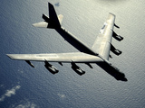 A B-52 Stratofortress in Flight Over the Pacific Ocean Photographic Print by Stocktrek Images
