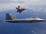 Two F-22 Raptors Release Flares While Flying Over Japan Photographic Print by Stocktrek Images