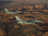 Two F-16's Fly in Formation Over Northern Arizona Photographic Print by Stocktrek Images