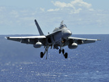 An F/A-18C Hornet Approaches the Flight Deck of the Aircraft Carrier USS Ronald Reagan Photographic Print by Stocktrek Images