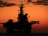 The Setting Sun Silhouettes the Amphibious Assault Ship USS Makin Island Photographic Print by Stocktrek Images