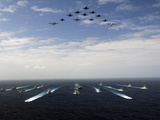 Aircraft Fly Over a Group of U.S. And Japanese Maritime Self-Defense Force Ships Photographic Print by Stocktrek Images