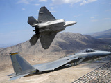 An F-22 Raptor Aircraft Turns Away While An F-15 Eagle Flies the Approach Over Nevada Photographic Print by Stocktrek Images