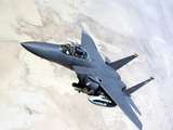 An F-15E Strike Eagle Turns Away After Recieving Fuel Photographic Print by Stocktrek Images