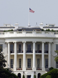 The American Flag Flies at Half-staff Atop the White House Photographic Print by Stocktrek Images