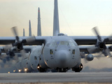 C-130 Hercules Aircraft Taxi Out For a Mission During a Six-ship Sortie Photographic Print by Stocktrek Images