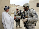 U.S. Army Soldier Shakes Hands with An Elder in a Village in Afghanistan Photographic Print by Stocktrek Images