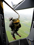 A Paratrooper Executes An Airborne Jump Out of a C-17 Globemaster III Photographic Print by Stocktrek Images