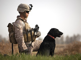 U.S. Marine Holds Security in a Field with His IED Detection Dog Photographic Print by Stocktrek Images