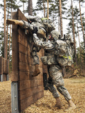 U.S. Army Soldiers Climb Over An Obstacle in Grafenwoehr, Germany Photographic Print by Stocktrek Images