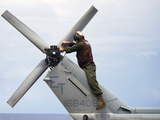 A Marine Conducts Maintenance On the Tail of An UH-1N Huey Helicopter Photographic Print by Stocktrek Images