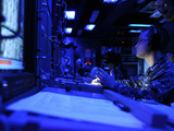 Sonar Technician Stands Watch in the Combat Information Center Aboard USS Bunker Hill Photographic Print by Stocktrek Images