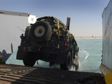 A Humvee Drives Down the Ramp of a Landing Craft Utility Photographic Print by Stocktrek Images