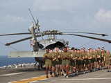 Marines And Sailors Run Aboard USS Makin Island Photographic Print by Stocktrek Images