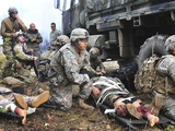 Pararescuemen Prepare To Transport Wounded Soldiers Photographic Print by Stocktrek Images
