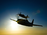 Silhouette of Two Grumman F8F Bearcats in Flight Photographic Print by Stocktrek Images