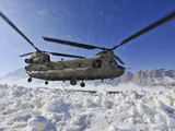 Snow Flies Up As a U.S. Army CH-47 Chinook Helicopter Prepares To Land Photographic Print by Stocktrek Images