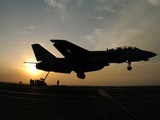An F-14D Tomcat Makes An Arrested Landing As the Sun Sets Photographic Print by Stocktrek Images