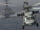 n MH-60S Knight Hawk Delivers Supplies To USS Carl Vinson Photographic Print by Stocktrek Images