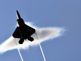 A U.S. Air Force F-22 Raptor Aircraft Executing a Supersonic Flyby Photographic Print by Stocktrek Images