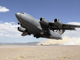 A C-17 Globemaster Departs from the Tonopah Runway Photographic Print by Stocktrek Images
