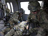 U.S. Army Flight Medics Aid a Simulated Casulaty in a UH-60 Black Hawk Photographic Print by Stocktrek Images