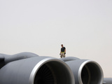 A Crew Chief Walks the Wing of a KC-135 Photographic Print by Stocktrek Images
