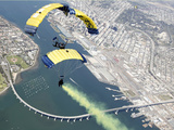 Members of the U.S. Navy Parachute Team Above Naval Amphibious Base Coronado Photographic Print by Stocktrek Images