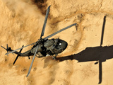 A UH-60 Black Hawk Helicopter Comes in For a Dust Landing Photographic Print by Stocktrek Images